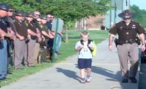 Officers form honor guard for 5-year-old boy whose father was killed in line of duty