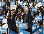 AOC never mentions Bernie Sanders' name as she and Michael Moore pinch-hit for candidate at Iowa rally