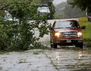 Flooded Louisiana cleans up from Barry but dodges 'worst-case scenario'; storm moves north dumping more rain