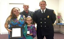 9-year-old Girl Scout honored for saving mom from overturned car